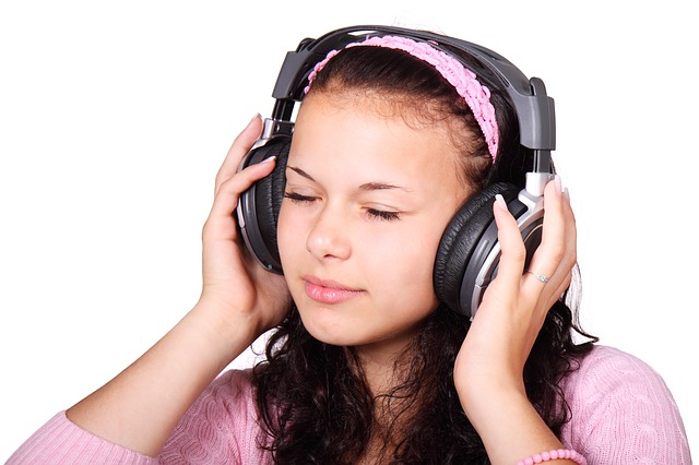 a young girl listening on headphones