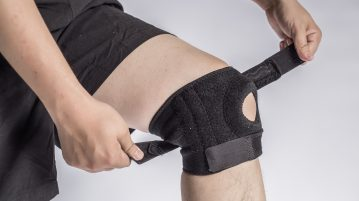 a man putting on a knee brace